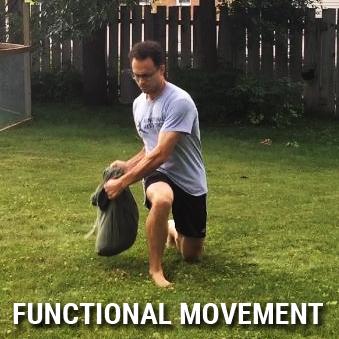 functional movement - rotational lunge with sandbag